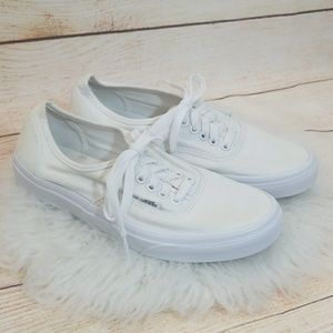 Vans all white low top lace up skate tennis shoes